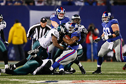 New York Giants running back Ahmad Bradshaw #44 is tackled by Eagles defenseman during the NFL game between the Philadelphia Eagles and the New York Giants on December 13th 2009. The Eagles won 45-38 at Giants Stadium in East Rutherford, New Jersey. (Photo By Brian Garfinkel)
