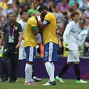 Lucas, Brazil, is consoled by team mate Thiago Silva (right) after defeat during the Brazil V Mexico Gold Medal Men's Football match at Wembley Stadium during the London 2012 Olympic games. London, UK. 11th August 2012. Photo Tim Clayton