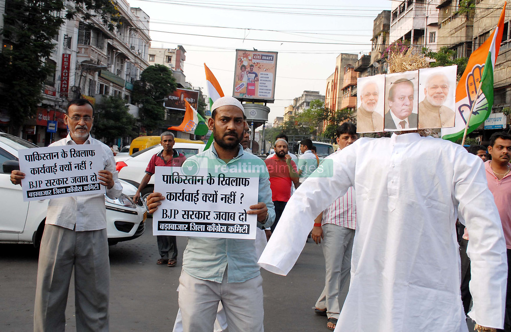 May 3, 2017 - Kolkata, West Bengal, India - Indian Political Party Congress workers today burn Pakistan National flag and  Pakistam Prime Minister Nawaz Sharif Effigy and protest against killing  Indian Army Soldiers  in Kasmir on May 03,2017 in Kolkata,India. (Credit Image: © Debajyoti Chakraborty/NurPhoto via ZUMA Press)