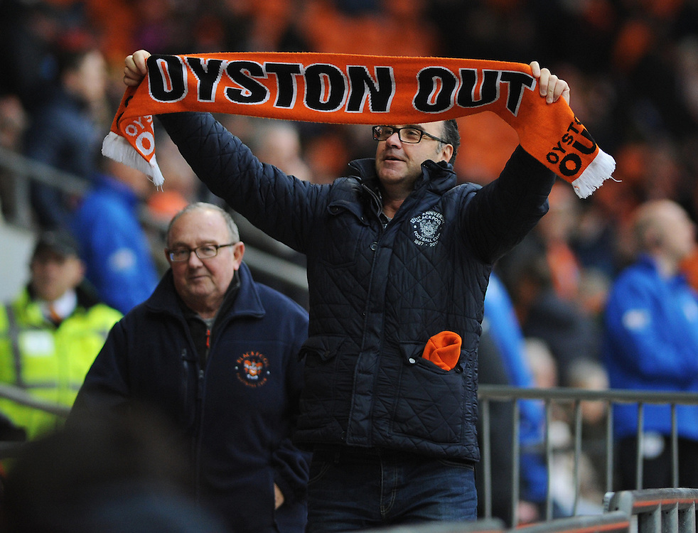 A Blackpool fan protests with an 'Oyston Out' scarf whilst leaving early after Wigan Athletic's second goal<br /> <br /> Photographer Kevin Barnes/CameraSport<br /> <br /> Football - The Football League Sky Bet Championship - Blackpool v Wigan Athletic - Saturday 28th February 2015 - Bloomfield Road - Blackpool<br /> <br /> © CameraSport - 43 Linden Ave. Countesthorpe. Leicester. England. LE8 5PG - Tel: +44 (0) 116 277 4147 - admin@camerasport.com - www.camerasport.com