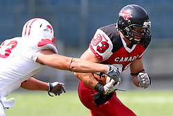 13.07.2011, UPC Arena, Graz, AUT, American Football WM 2011, Group B, Japan (JAP) vs Canada (CAN), im Bild Masayoshi Yamanaka (Japan, #13, DL) tries to tackle Matt Walters (Canada, #33, RB)  // during the American Football World Championship 2011 Group B game, Japan vs Canada, at UPC Arena, Graz, 2011-07-13, EXPA Pictures © 2011, PhotoCredit: EXPA/ T. Haumer