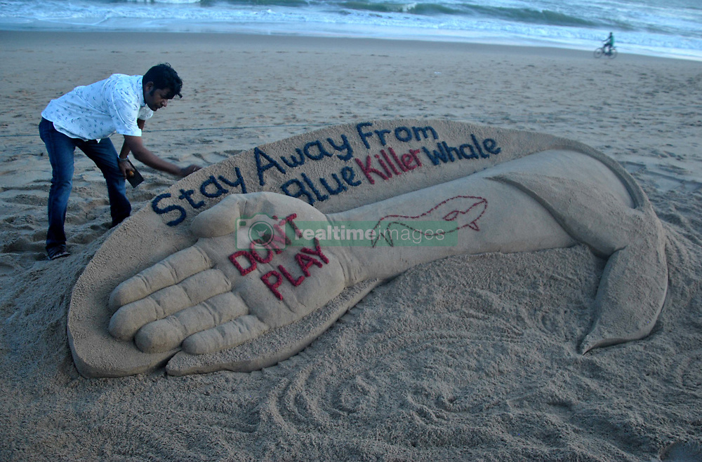September 11, 2017 - Bhubaneswar, India - Indian sand artist Sudarshan Patnaik is creating a sand sculpture about the Blue Whale game for public awareness at the Bay of Bengal Sea's eastern coast beach at Puri, 65 km away from the eastern Indian state Odisha's capital city Bhubaneswar. (Credit Image: © Str/NurPhoto via ZUMA Press)