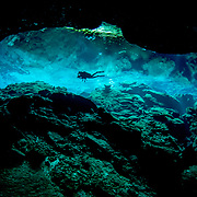 A diver explores Chac Mool Cenote (or sinkhole) in Quintana Roo, Mexico.