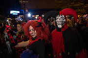 New York, NY - October 31, 2015. Horned revelers, one with a deaths head, in the Greenwich Village Halloween Parade.