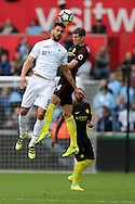 Fernando Llorente of Swansea city (l) jumps for a header with John Stones of Manchester city.  Premier league match, Swansea city v Manchester city at the Liberty Stadium in Swansea, South Wales on Saturday 24th September 2016.<br /> pic by Andrew Orchard, Andrew Orchard sports photography.