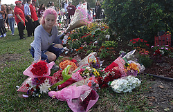 Victoria Gonzalez rearranges flowers at the memorial garden outside Marjory Stoneman Douglas High School in Parkland, Fla. on Wednesday, February 14, 2019, on the anniversary of the shooting at the school. Gonzalez was the girlfriend of Joaquin Oliver and the garden was her project. Photo by Joe Cavaretta/Sun Sentinel/TNS/ABACAPRESS.COM