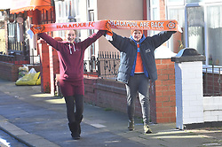 Two young blackpool fans celebrate before the match