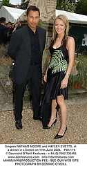 Singers NATHAM MOORE and HAYLEY EVETTS, at a dinner in London on 17th June 2004.  PWI 119