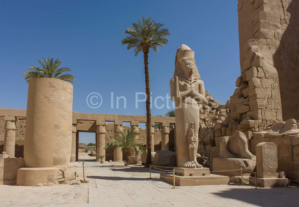 A landscape void of tourists showing the giant colossus of Pharaoh Ramesses ll and his daughter Bintanath at the ancient Egyptian Temple of Karnak, Luxor, Nile Valley, Egypt. According to the country's Ministery of Tourism, European visitors to Egypt  is down by up to 80% in 2016 after the suspension of flights after the downing of the Russian airliner in Oct 2015. Euro-tourism accounts for 27% of the total flow and in total, tourism accounts for 11.3% of Egypt's GDP.