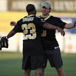 Apr 28, 2010; Metairie, LA, USA; Drew Brees (9) celebrates with Pierre Thomas (23) during the Heath Evans Foundation charity softball featuring teammates of the Super Bowl XLIV Champion New Orleans Saints at Zephyrs Field.  Mandatory Credit: Derick E. Hingle-US-PRESSWIRE.