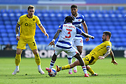 Reading defender Omar Richards (3) is challenged by Barnsley's Alex Mowatt (27) during the EFL Sky Bet Championship match between Reading and Barnsley at the Madejski Stadium, Reading, England on 19 September 2020.