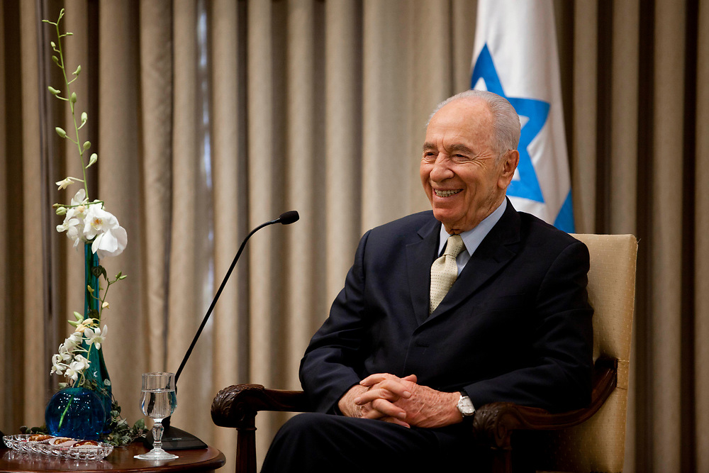 Israel's President Shimon Peres smiles as he speaks during his meeting with four of the founding members of The Friends of Israel Initiative, at the President's Residence in Jerusalem on July 14, 2011.