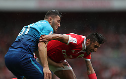 29 July 2017 London : Emirates Cup - Arsenal v Benfica - Arsenal defender Sead Kolasinac struggles to contain Toto Salvio of Benfica (right).<br /> Photo: Mark Leech