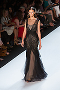 Black gown with sequins and tulle. By Monique Lhuillier at Spring 2013 Fall Fashion Week in New York.