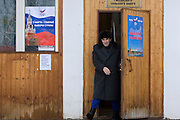 Rechitsy, Russia, 02/03/2008..A voter emerges from a polling station as Russians vote during the Presidential election that President Vladimir Putin's chosen heir Deputy Prime Minister Dmitry Medvedev is expected to win easily in the first round.