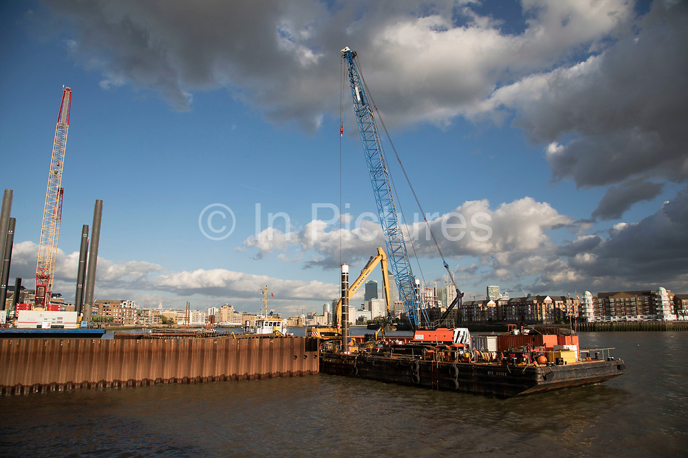 Construction work underway on the Thames Tideway Tunnel or Super Sewer on the River Thames near Wapping in London, England, United Kingdom. The Thames Tideway Tunnel is an under-construction civil engineering project 25 km tunnel running mostly under the tidal section of the River Thames through central London, which will provide capture, storage and conveyance of almost all the combined raw sewage and rainwater discharges that currently overflow into the river.