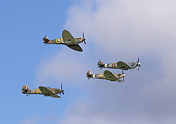© London News Pictures. The 15th September 2015 marked the 75th anniversary of Victory for the Royal Air Force in the Battle of Britain. An estimated 40 Spitfires, Hurricanes and a Blenheim from across the UK, USA and Europe came together at the Goodwood Aerodrome, West Sussex, to take part in an historic flypast over the South of England. This event brought together in one place more Battle of Britain aircraft than at any time since World War Two. . Photo credit: Richard Goldschmidt/LNP