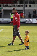 Rene Howe of Newport on the pitch with his child at the end of the game. Skybet football league two match, Newport county v Rochdale at Rodney Parade in Newport, South Wales on Saturday 3rd May 2014.<br /> pic by Mark Hawkins, Andrew Orchard sports photography.