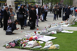 May 24, 2017 - Manchester, United Kingdom - Image ©Licensed to i-Images Picture Agency. 24/05/2017. Manchester, United Kingdom. People near Albert Square  in Manchester look at the growing amount of floral tributes  for the victims of the Manchester terror attack . Picture by Stephen Lock / i-Images (Credit Image: © Stephen Lock/i-Images via ZUMA Press)