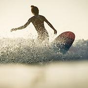 Nique Miller surfing at Queen's in Waikiki, Hawaii.  Girls at the beach.