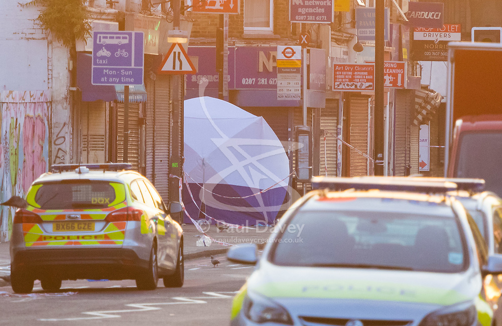 """Finsbury Park, London, June 19th 2017. A major police and emergency services operation with firearms officers in attendance is underway near Finsbury Park Mosque following reports of Several people being injured after a van struck a crowd of pedestrians near a north London mosque in what police have called a """"major incident"""". PICTURED: A police tent at the scene of the incident."""
