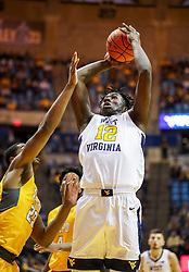 Nov 24, 2018; Morgantown, WV, USA; West Virginia Mountaineers forward Andrew Gordon (12) shoots during the second half against the Valparaiso Crusaders at WVU Coliseum. Mandatory Credit: Ben Queen-USA TODAY Sports