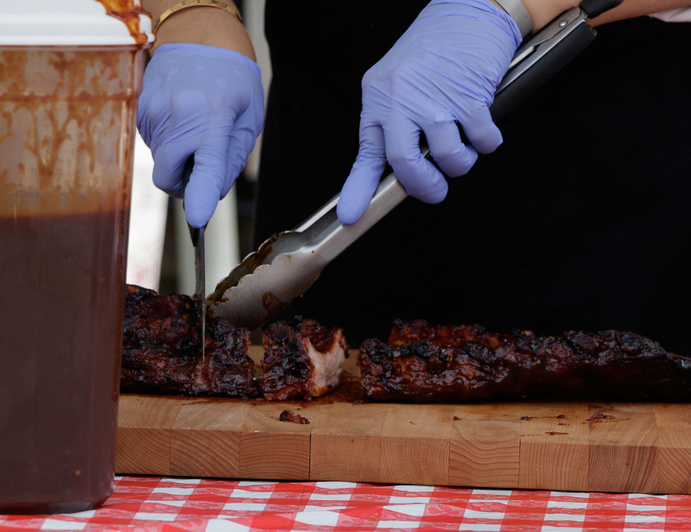 Cutting smoked ribs at the barbecue competition.