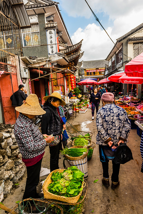 Street vegetable market in the Old Town (Dali Gucheng), Dali, Yunnan Province, China.