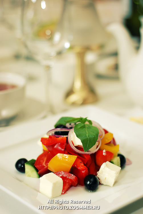 Healthy green salad on white plate in luxury restaurabt