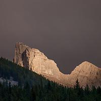 Sunset illuminates a crag in the Canadian Rockies.