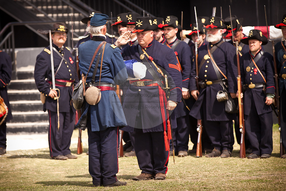 A re-enactor portraying Union officer Maj. Robert Anderson receives the US Flag on the 150th anniversary of the surrender of the fort in the US Civil War on April 14, 2011 in Charleston, South Carolina.  The surrender of the fort marks the end of a week long commemoration of the start of the Civil War.