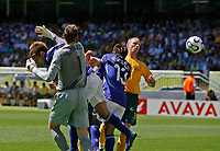 Photo: Glyn Thomas.<br />Australia v Japan. Group F, FIFA World Cup 2006. 12/06/2006.<br />Australia's goalkeeper Mark Schwarzer (L) sees Nakamura's cross sail past him to give Japan a 1-0 lead at half time.