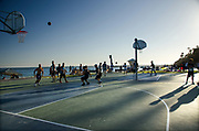 Playing Basketball at the Beach at Sunset in Laguna Beach California