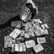 A woman dries her identity papers after crossing the Nap River by night near Sha Pohrir DwipSince the end of august 2017, the beginning of the crisis, more than 600,000 Rohingyas have fled Myanmar to seek refuge in Bangladesh. Cox's Bazar - november 5th 2017.<br /> Une femme fait sécher ses papiers d'identité après avoir traversé la rivière Nap de nuit à proximité de Sha Pohrir Dwip. Depuis le début de la crise, fin août 2017, plus de 600000 Rohingyas ont fuit la Birmanie pour trouver refuge au Bangladesh. Cox's Bazar le 05 novembre 2017.