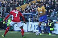 CJ Hamilton of Mansfield Town (22) looks to take on Mark Marshall of Charlton Athletic (7) during the The FA Cup match between Mansfield Town and Charlton Athletic at the One Call Stadium, Mansfield, England on 11 November 2018.