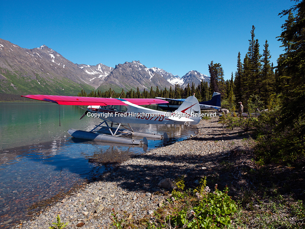 Pilots Ryan Twitchell and Mike Litzen on beach of Upper Twin Lake with Mike's Super Cub and Ryan's Cessna 185, Lake Clark National Park, Alaska.