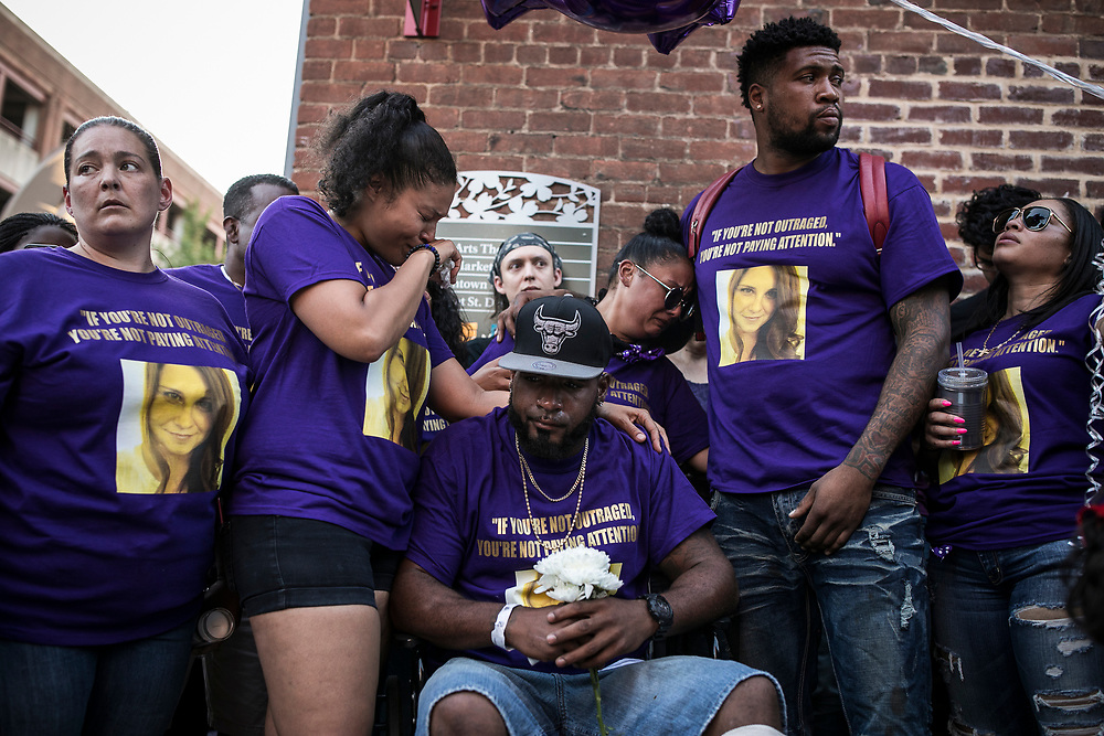 CHARLOTTESVILLE, VA. USA. August 13th 2017. Vigil for the victims in the riots in Charlottesville on Sunday night. In the center Markus Martin, a close friend of the victim and the person flying in the famous photo of the attack by the car. He is surrounded by other friends of Heather, all dressed in purple for the vigil. <br /> <br /> <br /> The rally occurred amidst the backdrop of controversy generated by the removal of Confederate monuments throughout the country in response to the Charleston church shooting in 2015. The event turned violent after protesters clashed with counter-protesters, which combined with the subsequent vehicle-ramming attack left over 30 injured