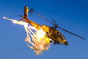 Israeli Air force (IAF) Boeing Apache AH-64A (Peten) Helicopter in flight Emitting anti-missile flares