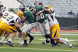 12 November 2011:  Erik Westerberg gets his arms around Devonte Jones during an NCAA division 3 football game between the Augustana Vikings and the Illinois Wesleyan Titans in Tucci Stadium on Wilder Field, Bloomington IL