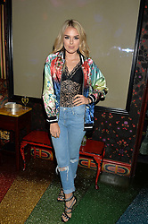 TALIA STORM at a party hosted by fashion website Farfetch to launch i.am + EPs headphones hosted by Will.i.am at Loulou's, 5 Hertford Street, London on 16th September 2016.