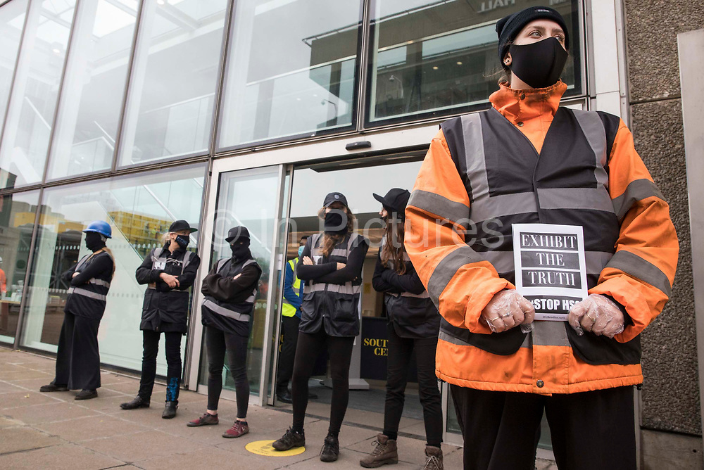Activists dressed as HS2 enforcement agents and workers take part in a HS2 Chainsaw Massacre protest outside the Among The Trees exhibition at the Hayward Gallery on 30 October 2020 in London, United Kingdom. The protest was intended to highlight both the daily environmental destruction being wrought for the controversial HS2 high-speed rail project and instances of violence and brutality by security guards and bailiffs working on behalf of HS2 Ltd.
