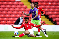 Jack Hunt of Bristol City is tackled by Clarke Oduor of Barnsley - Mandatory by-line: Robbie Stephenson/JMP - 17/10/2020 - FOOTBALL - Oakwell Stadium - Barnsley, England - Barnsley v Bristol City - Sky Bet Championship