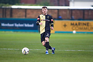 Marine defender James Joyce (3) plays a pass during the The FA Cup match between Marine and Havant & Waterlooville FC at Marine Travel Arena, Great Crosby, United Kingdom on 29 November 2020.