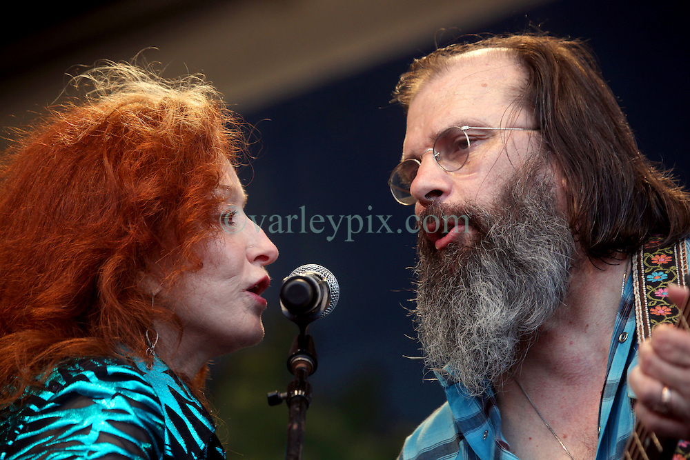 05 May 2012. New Orleans, Louisiana,  USA. .New Orleans Jazz and Heritage Festival. .Steve Earle and 9 time Grammy winner Bonnie Raitt perform with the 'Preservation Hall and Friends' ensemble. .Photo; Charlie Varley.
