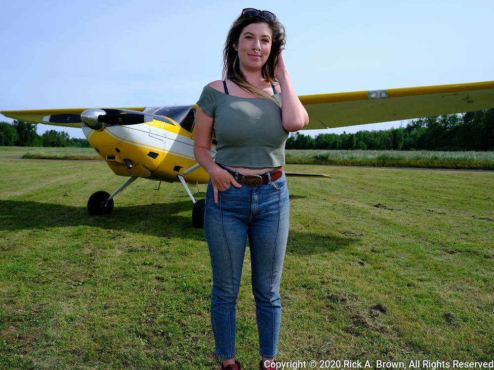 Young woman and her Cessna Skywagon.