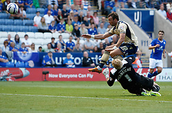 Leicester City's Kasper Schmeichel makes a brave save from Leeds United's Noel Hunt  - Photo mandatory by-line: Matt Bunn/JMP - Tel: Mobile: 07966 386802 11/08/2013 - SPORT - FOOTBALL - King Power Stadium - Leicester -  Leicester City v Leeds United - Sky Bet Championship