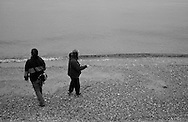 2011 September 14 - Two women, Alki Beach, Seattle, WA, USA. Copyright Richard Walker