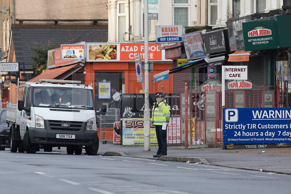 © Licensed to London News Pictures. 12/11/2017. LONDON, UK.  Police officers at the row of shops and take aways within the police cordon and crime scene at High Road in Ilford. At 02:48 this morning, police were called to the scene, where a man had been beaten by a group of men with what is thought to have been baseball bats. The man was taken to an east London hospital by London Ambulance Service where he died at 04:35.  Photo credit: Vickie Flores/LNP