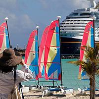 Caribbean, Bahamas, Castaway Cay. Woman taking picture at Castaway Cay.