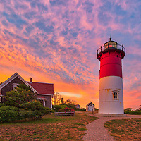 Nauset Light is one of the most iconic Cape Cod lighthouses. It is located in the town of Eastham, Massachusetts next to Nauset Beach and not far from Coastguard Beach along the Cape Cod National Seashore. Visiting Cape Cod and the Islands is always a lot of fun. I finally was able to head out to photograph Nauset Lighthouse at sunset when the sky exploded into beautiful colors. <br />